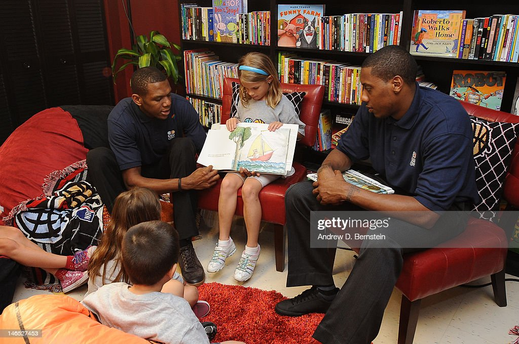 James Jones and <a gi-track='captionPersonalityLinkClicked' href=/galleries/search?phrase=Mario+Chalmers&family=editorial&specificpeople=802115 ng-click='$event.stopPropagation()'>Mario Chalmers</a> of the Miami Heat attend the unveiling of the NBA Cares Learn and Play Center at the Miami Springs Community Center presented by HP and State Farm on June 18, 2012 in MIami, Florida.