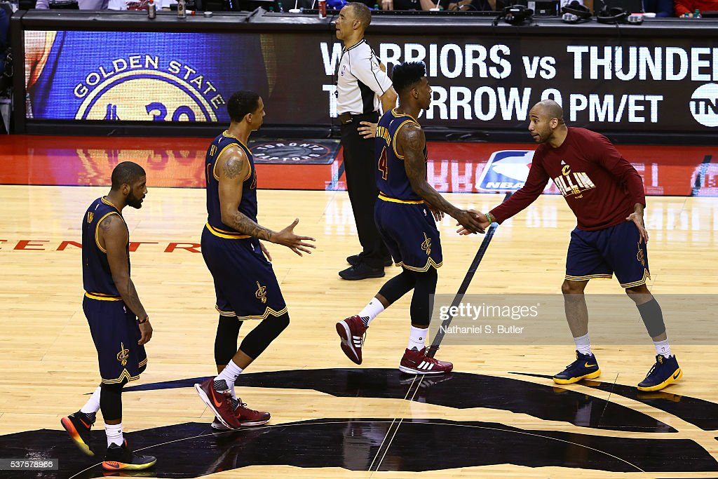 James Jones #1, Channing Frye #9, Iman Shumpert #4 and Dahntay Jones #30 of the Cleveland Cavaliers shake hands during Game Six of the NBA Eastern Conference Finals against the Toronto Raptors at Air Canada Centre on May 27, 2016 in Toronto, Ontario, Canada.