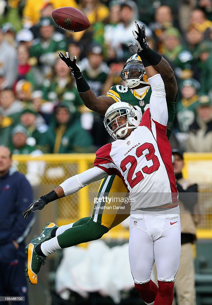 James Jones #89 of the Green Bay Packers catches a touchdown pass over Jamell Fleming #23 of the Arizona Cardinals at Lambeau Field on November 4, 2012 in Green Bay, Wisconsin.