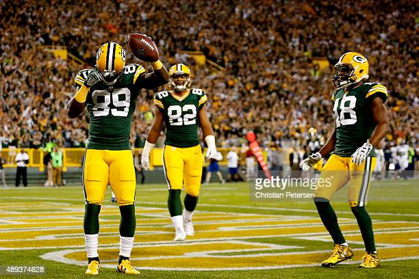 James Jones of the Green Bay Packers celebrates after scoring a touchdown thrown by Aaron Rodgers in the first quarter against the Seattle Seahawks...