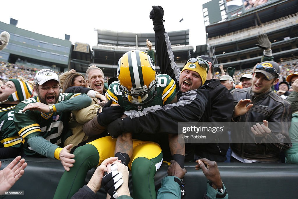 James Jones #89 of the Green Bay Packers celebrates with fans after a 32-yard touchdown reception against the Minnesota Vikings during the first half of the game at Lambeau Field on December 2, 2012 in Green Bay, Wisconsin.