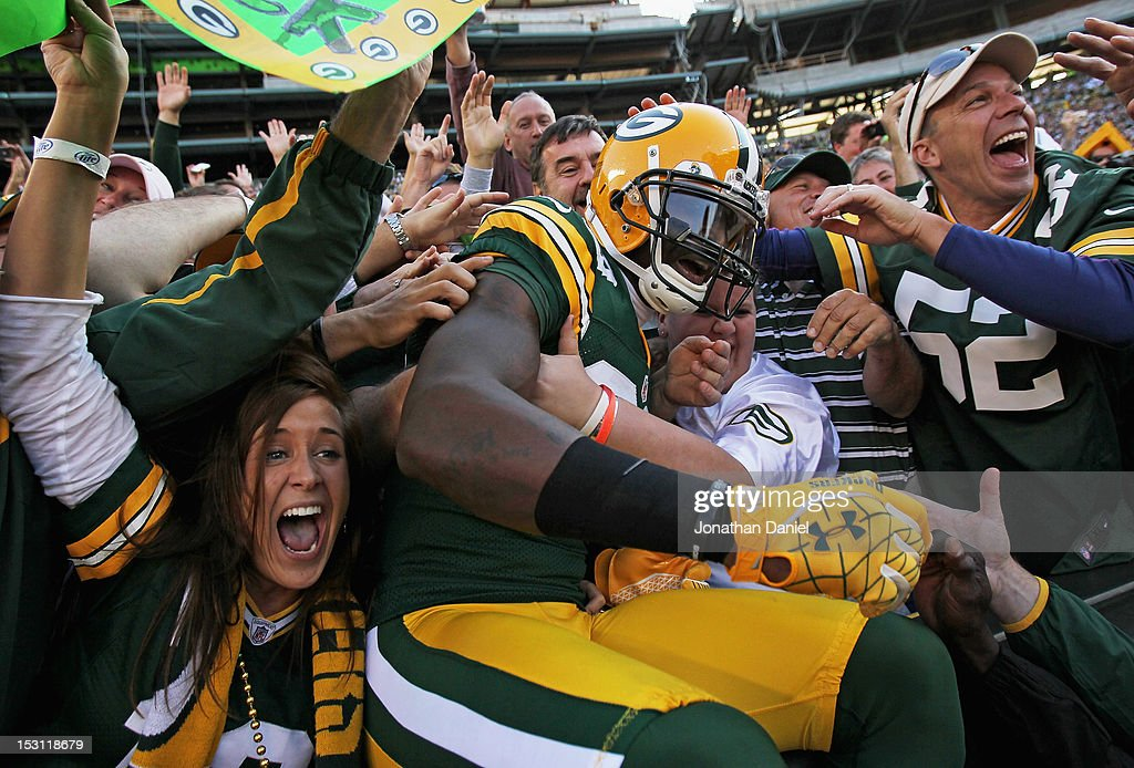 James Jones #89 of the Green Bay Packers leaps into the stands after catching a touchdown pass against the New Orleans Saints at Lambeau Field on September 30, 2012 in Green Bay, Wisconsin.