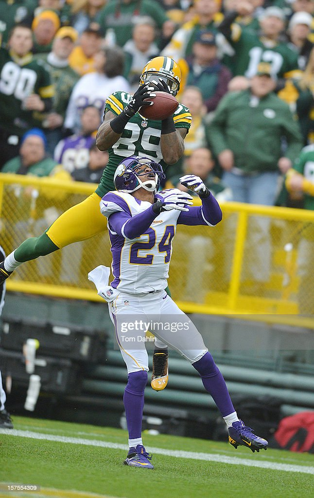 James Jones #89 of the Green Bay Packers makes a touchdown catch under pressure from A.J. Jefferson #24 of the Minnesota Vikings during an NFL game at Lambeau Field on December 2, 2012 in Green Bay, Wisconsin.