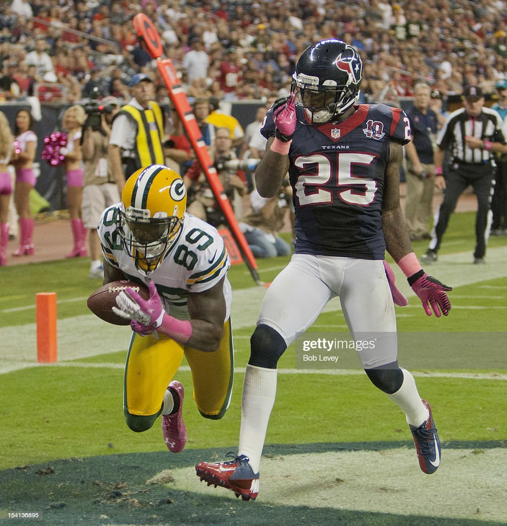 James Jones #89 of the Green Bay Packers reaches around Kareem Jackson #25 of the Houston Texans to make a catch for a 18 yard score at Reliant Stadium on October 14, 2012 in Houston, Texas. Green Bay Packers defeated Houston 42-24.
