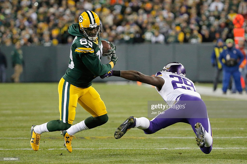 James Jones #89 of the Green Bay Packers runs with the ball as Xavier Rhodes #29 of the Minnesota Vikings attempts to tackle him during the first quarter of their game at Lambeau Field on January 3, 2016 in Green Bay, Wisconsin.