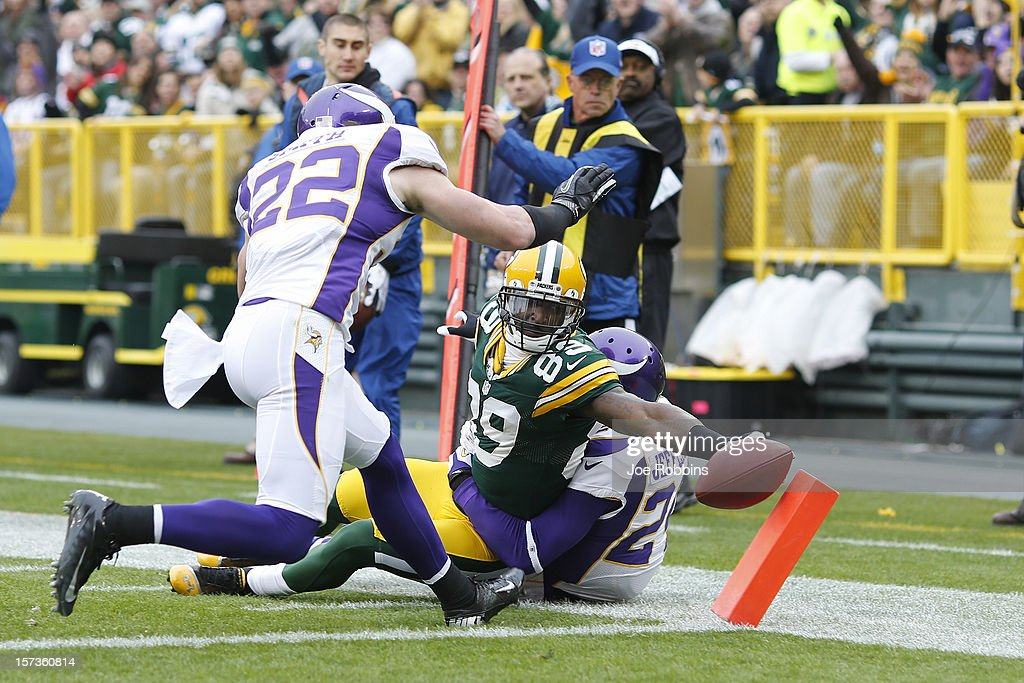 James Jones #89 of the Green Bay Packers scores a touchdown that was later negated by a penalty during the game against the Minnesota Vikings at Lambeau Field on December 2, 2012 in Green Bay, Wisconsin. The Packers won 23-14.