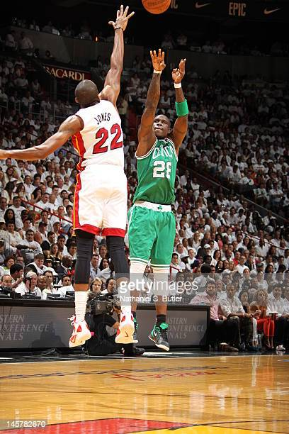 James Jones of the Miami Heat sends the ball against Mickael Pietrus of the Boston Celtics in Game Five of the Eastern Conference Finals between the...