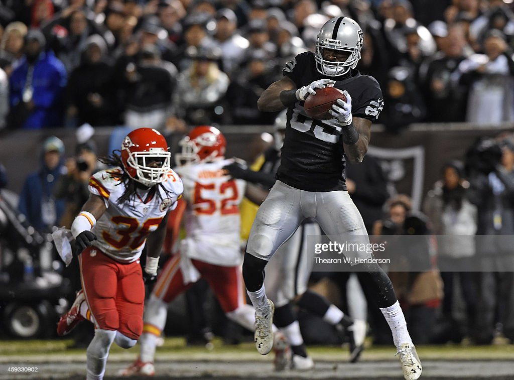 James Jones #89 of the Oakland Raiders catches the ball for a touchdown as Ron Parker #38 of the Kansas City Chiefs defends in the fourth quarter of the game at O.co Coliseum on November 20, 2014 in Oakland, California.