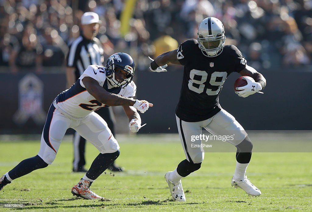 James Jones #89 of the Oakland Raiders fights off Aqib Talib #21 of the Denver Broncos in the first half at O.co Coliseum on November 9, 2014 in Oakland, California.