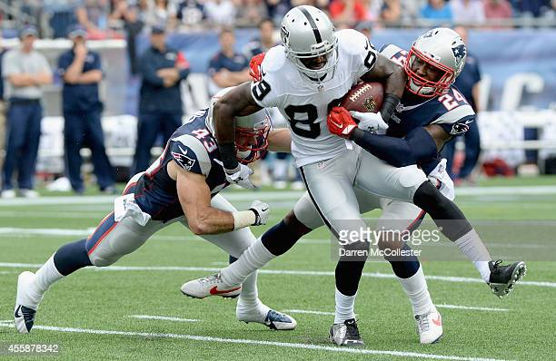 James Jones of the Oakland Raiders is tackled during the third quarter against the New England Patriots at Gillette Stadium on September 21 2014 in...