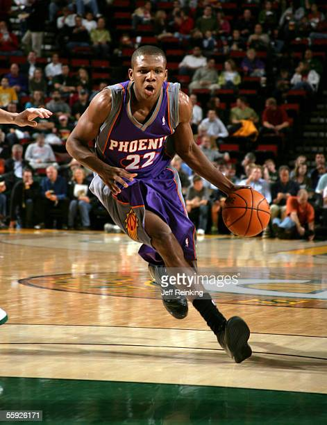 James Jones of the Phoenix Suns brings the ball up court against the Seattle SuperSonics at Key Arena on October 14 2005 in Seattle Washington NOTE...