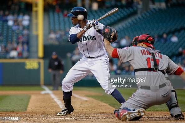 James Jones of the Seattle Mariners bats as a wild pitch from starting pitcher Jered Weaver of the Los Angeles Angels of Anaheim sails past his head...