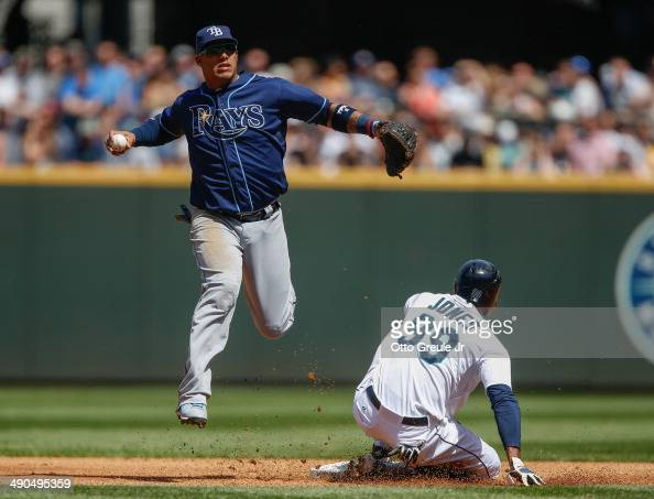 James Jones of the Seattle Mariners is put out at second base on a fielders choice play as shortstop Yunel Escobar of the Tampa Bay Rays leaps to...