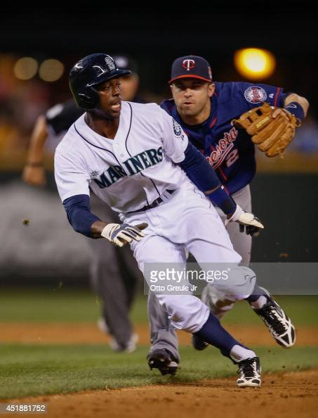 James Jones of the Seattle Mariners is put out by second baseman Brian Dozier of the Minnesota Twins on a double play to end the eighth inning at...
