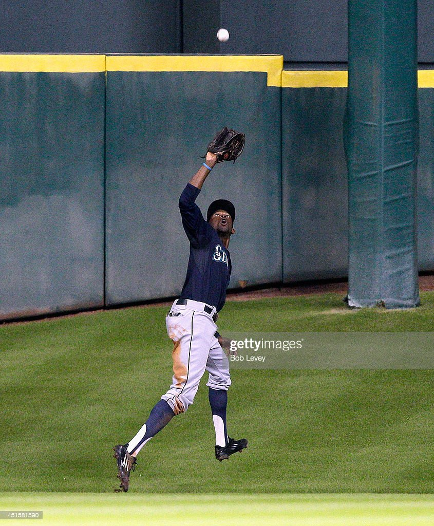 James Jones #99 of the Seattle Mariners makes a catch deep in center at Minute Maid Park on July 1, 2014 in Houston, Texas.