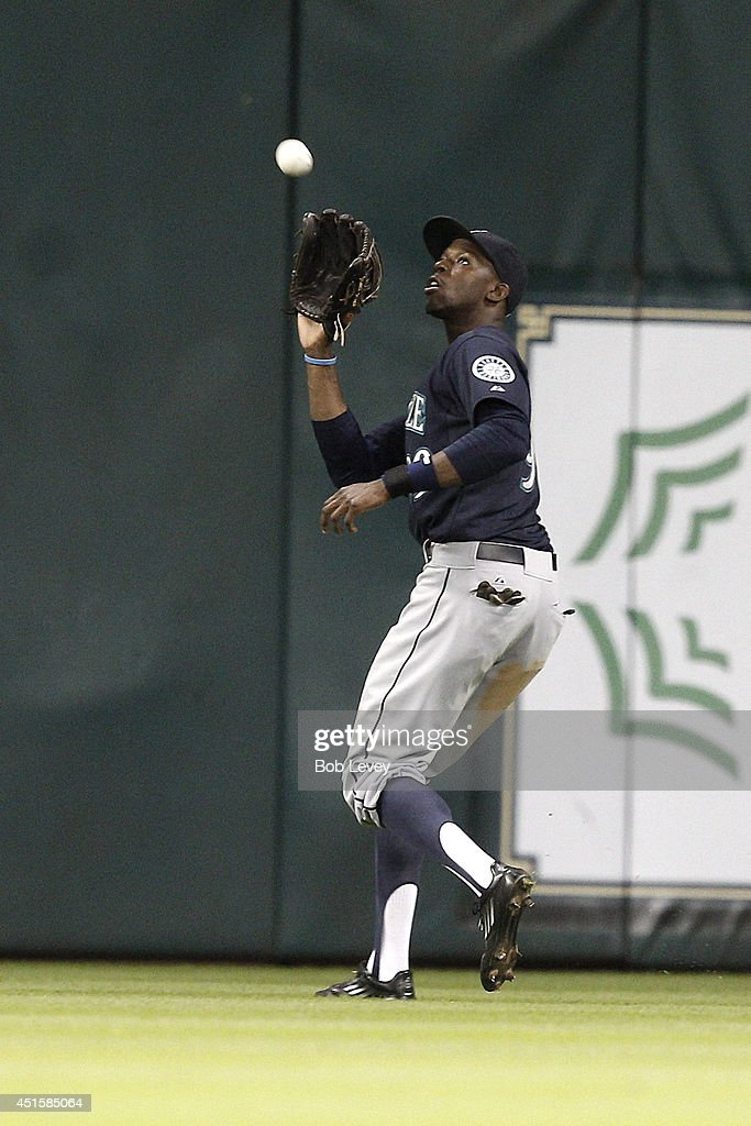 James Jones #99 of the Seattle Mariners makes catch in the ninth inning against the Houston Astros at Minute Maid Park on July 1, 2014 in Houston, Texas.
