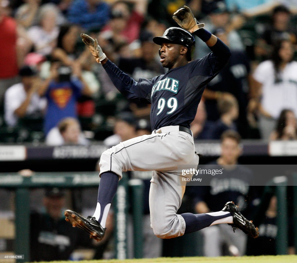 James Jones #99 of the Seattle Mariners scores in the sixth inning against the Houston Astros at Minute Maid Park on July 1, 2014 in Houston, Texas.