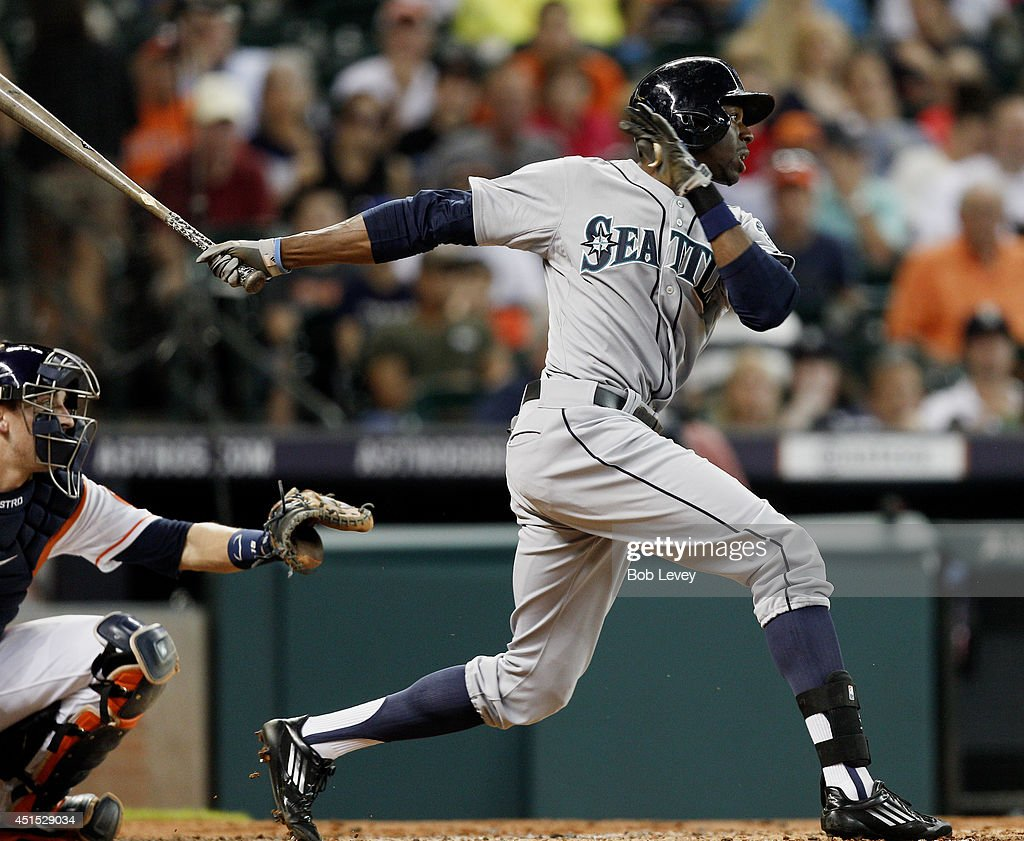 James Jones #99 of the Seattle Mariners singles in the third inning against the Houston Astros at Minute Maid Park on June 30, 2014 in Houston, Texas.