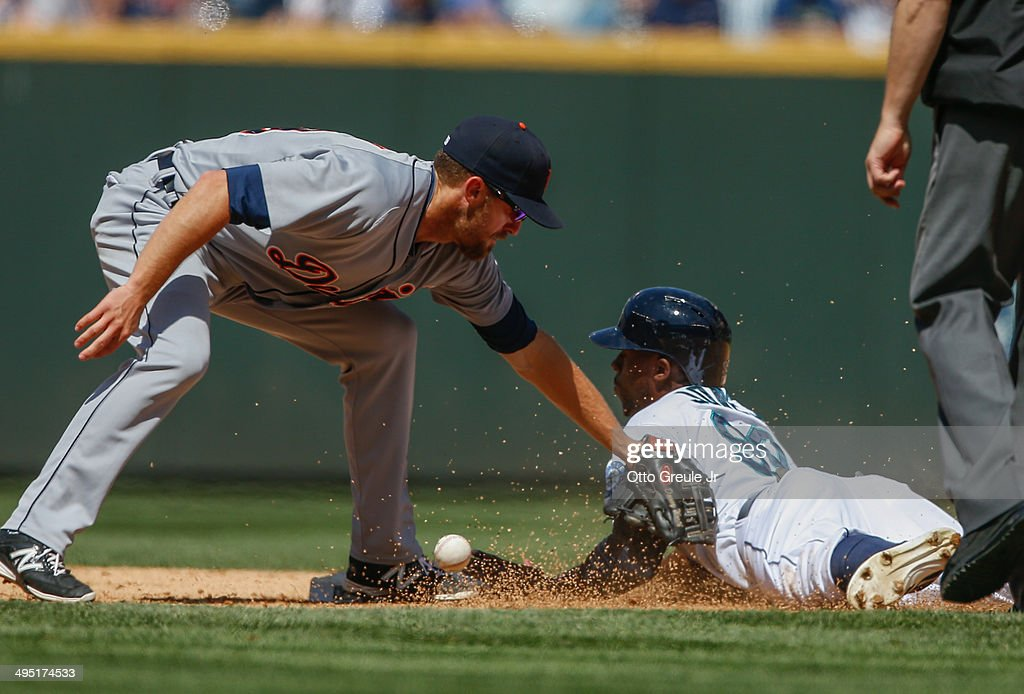 James Jones of the Seattle Mariners steals second base against shortstop Danny Worth of the Detroit Tigers in the fifth inning at Safeco Field on...