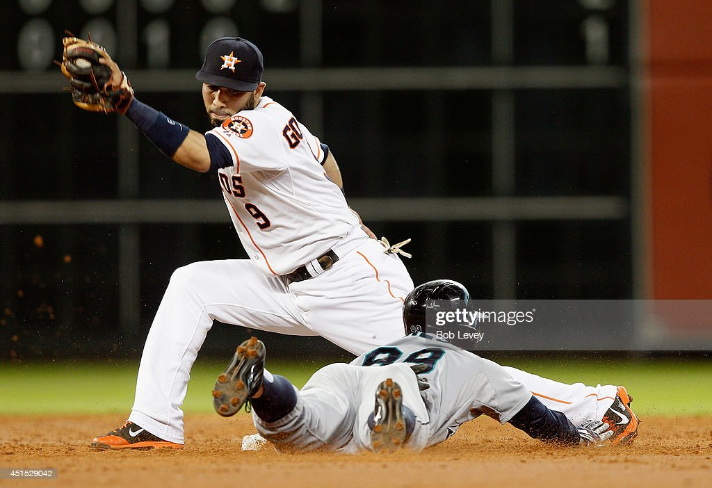 James Jones #99 of the Seattle Mariners steals second base in the third inning as Marwin Gonzalez #9 of the Houston Astros is late with the tag at Minute Maid Park on June 30, 2014 in Houston, Texas.