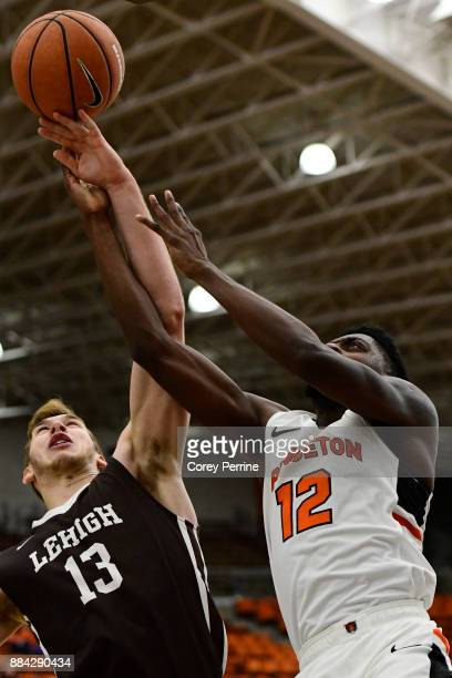 James Karnik of the Lehigh Mountain Hawks and Myles Stephens of the Princeton Tigers vie for the ball during the first half at L Stockwell Jadwin...