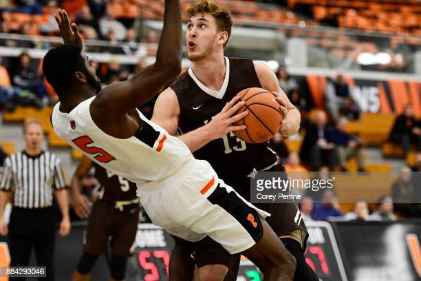 James Karnik of the Lehigh Mountain Hawks looks to score as Amir Bell of the Princeton Tigers flops during the second half at L Stockwell Jadwin...