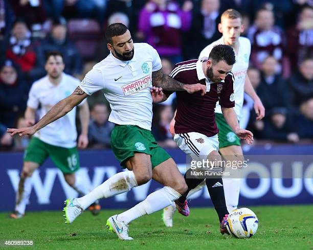 James Keatings of Hearts is tackled by Liam Fontaine of Hibernian during the Scottish Championship match between Heart of Midlothian FC and Hibernian...