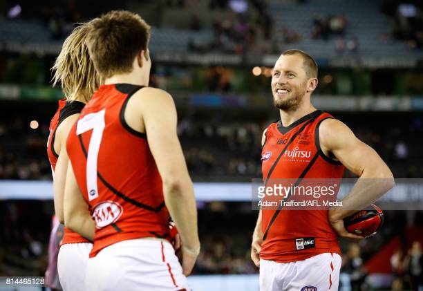 James Kelly of the Bombers celebrates with Dyson Heppell and Zach Merrett of the Bombers during the 2017 AFL round 17 match between the St Kilda...