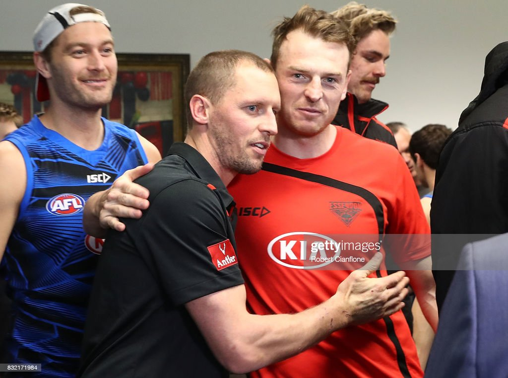 James Kelly of the Bombers is hugged by teammate Brendon Goddard after a press conference to announce his retirement at the Essendon Football Club on August 16, 2017 in Melbourne, Australia.