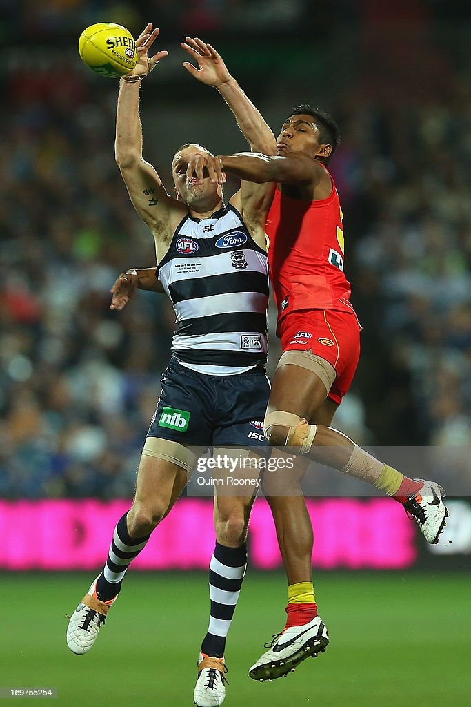 James Kelly of the Cats attempts to mark infront of Joel Wilkinson of the Suns during the round ten AFL match between the Geelong Cats and the Gold Coast Suns at Simonds Stadium on June 1, 2013 in Geelong, Australia.