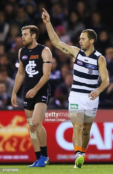 James Kelly of the Cats celebrates a goal next to Sam Docherty of the Blues during the round eight AFL match between the Geelong Cats and the Carlton...