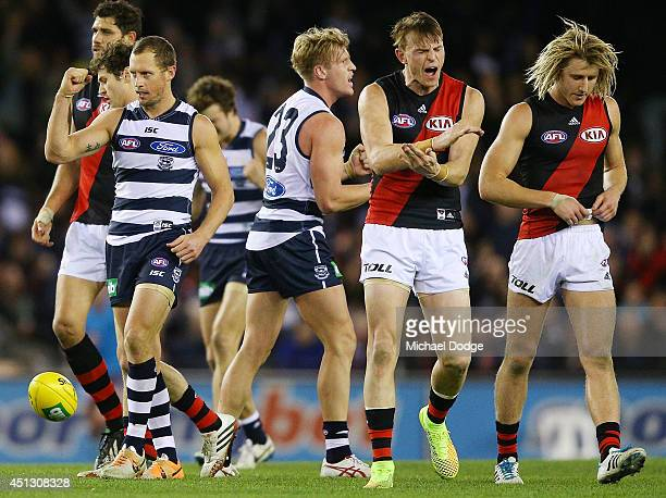 James Kelly of the Cats celebrates the win on he siren as Brendon Goddard and Dyson Heppell of the Bombers react during the round 15 AFL match...
