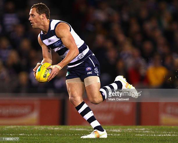 James Kelly of the Cats looks for a teammate during the round 18 AFL match between the Geelong Cats and the Richmond Tigers at Etihad Stadium on July...