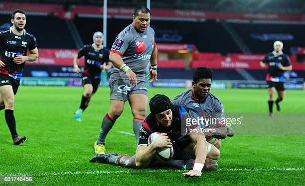 James King of Ospreys goes over for his sides try during the European Rugby Challenge Cup match between Ospreys and Lyon at the Liberty Stadium on...