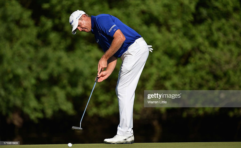 <a gi-track='captionPersonalityLinkClicked' href=/galleries/search?phrase=James+Kingston&family=editorial&specificpeople=226874 ng-click='$event.stopPropagation()'>James Kingston</a> of South Africa putts on the 12th green during the second round of the BMW International Open at Golfclub Munchen Eichenried on June 21, 2013 in Munich, Germany.