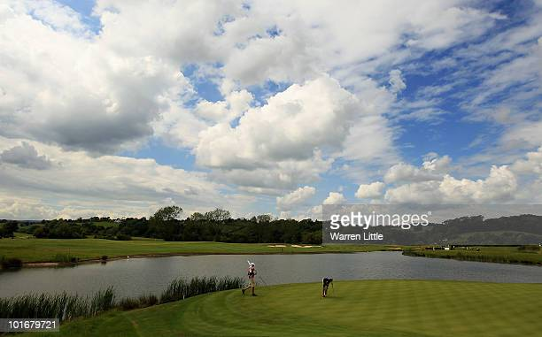 James Kingston of South Africa retrieves his ball from the hole on the 13th green during the final round of the Celtic Manor Wales Open on The Twenty...