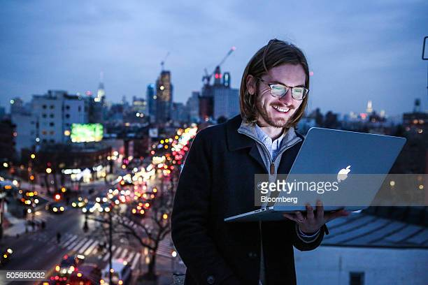 James Knight a 27yearold freelance coder smiles while standing for a photograph on a rooftop in the Brooklyn borough of New York US on Thursday Jan...