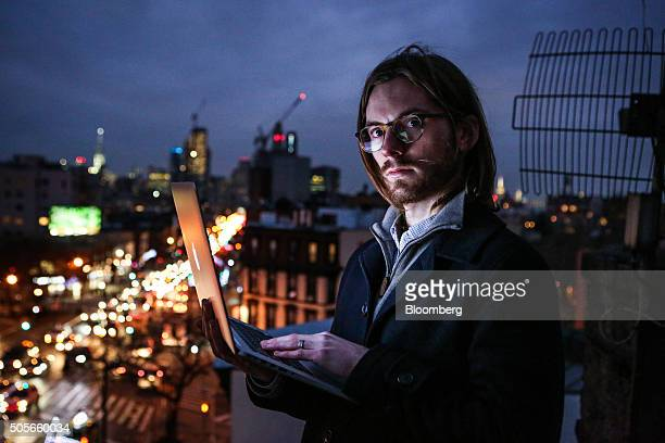 James Knight a 27yearold freelance coder stands for a photograph on a rooftop in the Brooklyn borough of New York US on Thursday Jan 14 2016 Knight...
