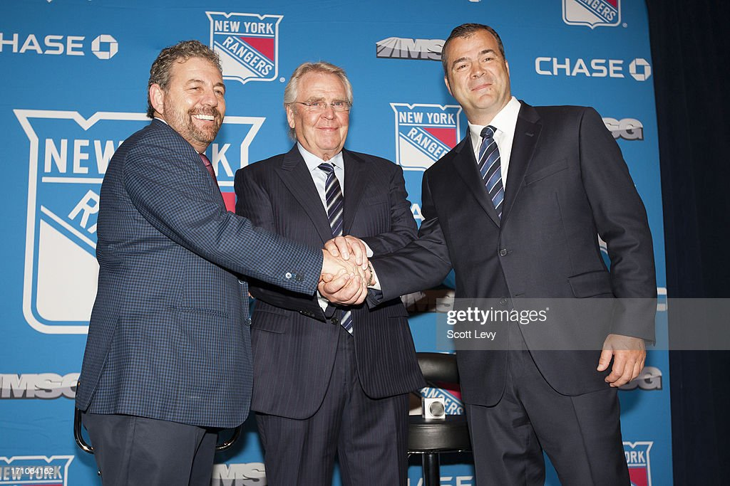 James L. Dolan, Executive Chairman of Madison Square Garden (L), and Glen Sather, General Manager of the New York Rangers (C), congratulate Alain Vigneault, the new head coach of the New York Rangers (R) shake hands at a press conference at Radio City Music Hall on June 21, 2013 in New York City.