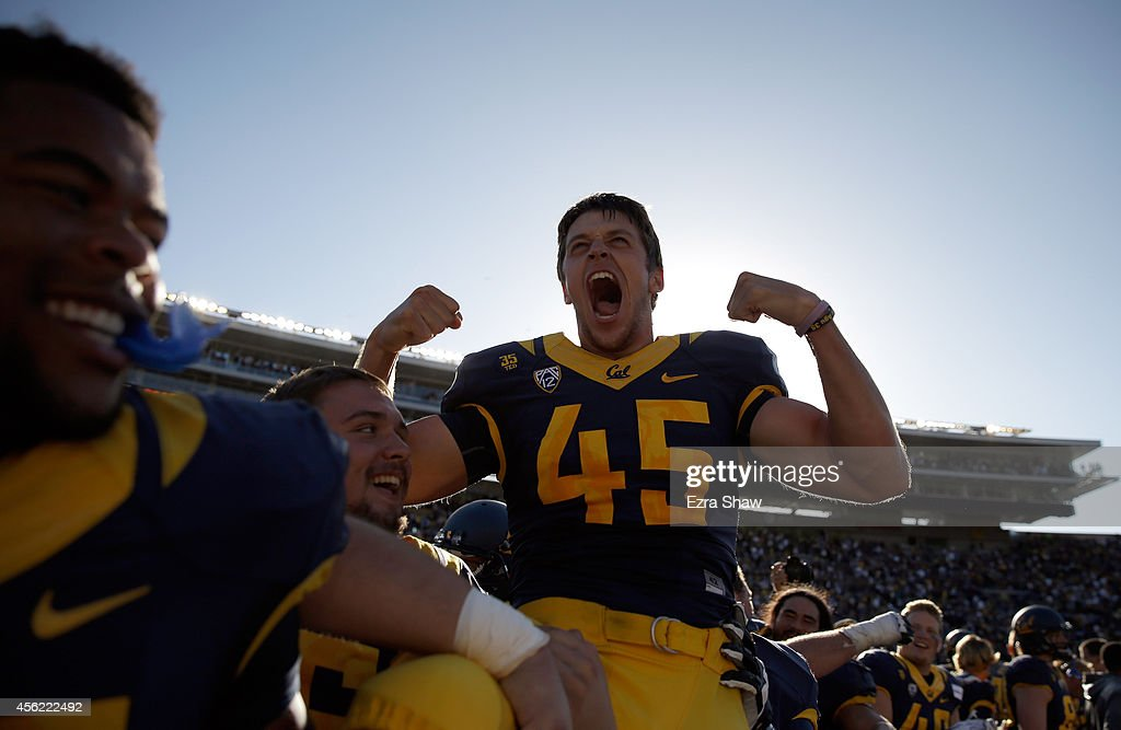 James Langford of the California Golden Bears is carried off the field by his teammates after he kicked the gamewinning field goal in double overtime...