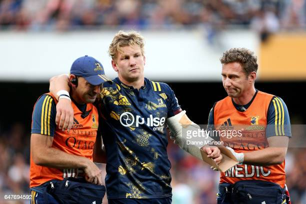 James Lentjes of the Highlanders leaves the field with an injury to his arm during the round two Super Rugby match between the Highlanders and the...