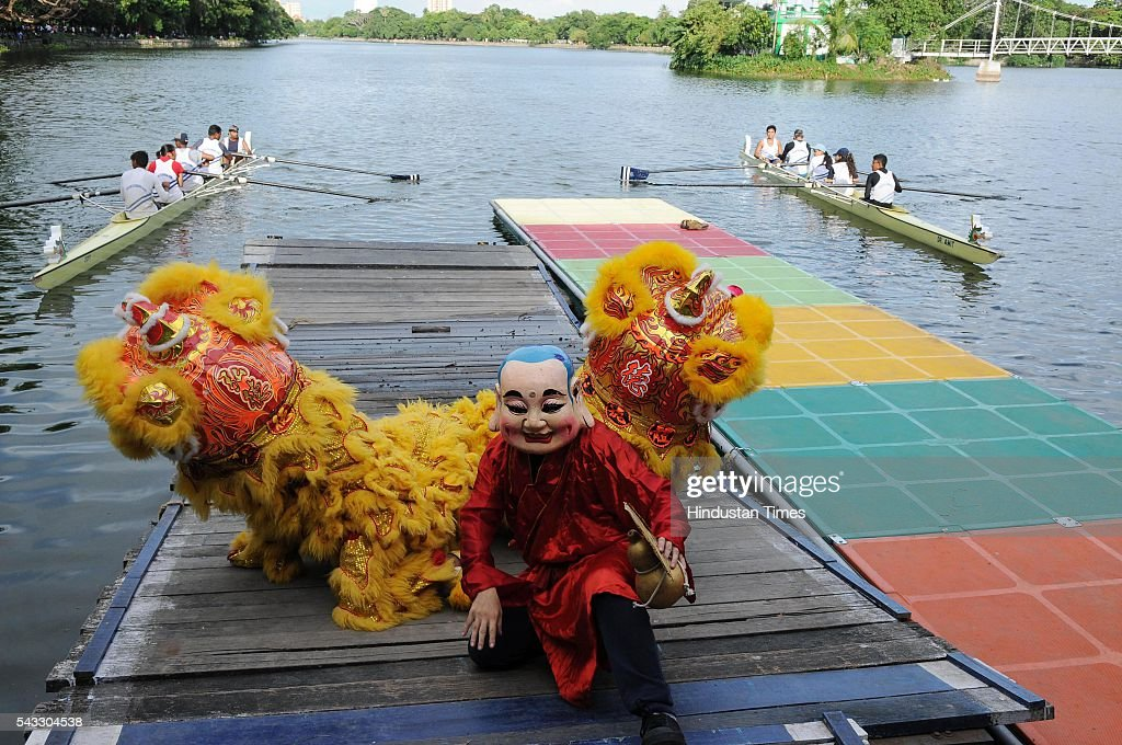 James Liao of Fitness Club, Tangra and his team present lion dance and flagged of boat race during Chinese Dragon Boat Festival at Rabindra Sarobar on June 26, 2016 in Kolkata, India. Kolkata has a largest Chinese population in India. Dragon Boat Race festival was started last year at Tiretti Bazaar, but this is first time boat race was being held. A crucial tie-up was done with Calcutta Rowing Club to host the first ever Dragon Boat Race at Rabindro Sarobor Lake.