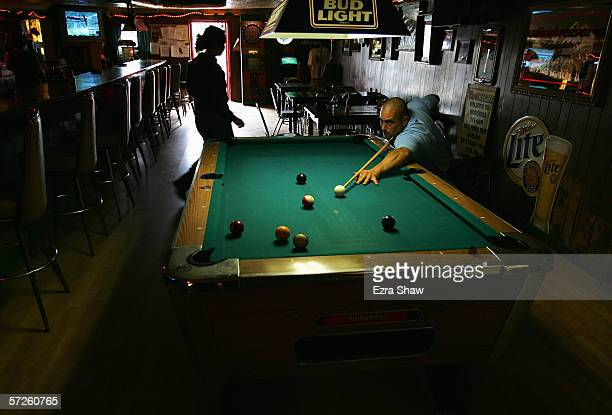 James Lilly plays pool in Moocher's Bar after day one of the Sadler's Ultra Challenge a 267mile wheelchair race from Fairbanks to Anchorage Alaska on...