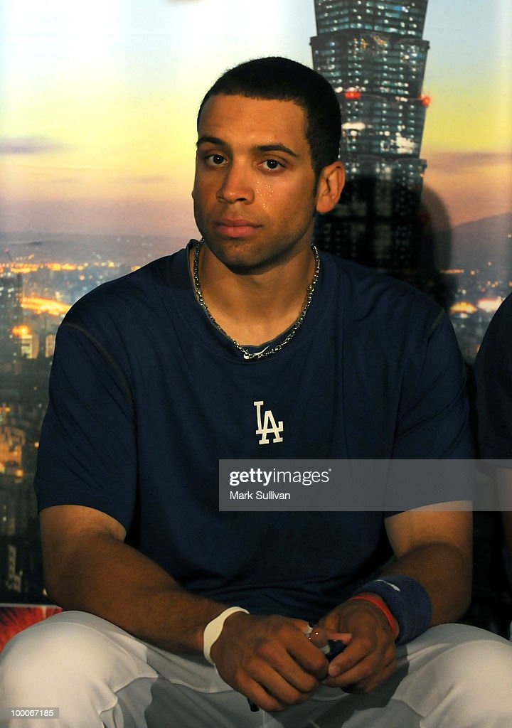 <a gi-track='captionPersonalityLinkClicked' href=/galleries/search?phrase=James+Loney&family=editorial&specificpeople=636293 ng-click='$event.stopPropagation()'>James Loney</a> of the Los Angeles Dodgers attends a news conference to announce expanded partnership between the Los Angeles Dodgers and Taiwan Tourism Board at Dodger Stadium on May 20, 2010 in Los Angeles, California.
