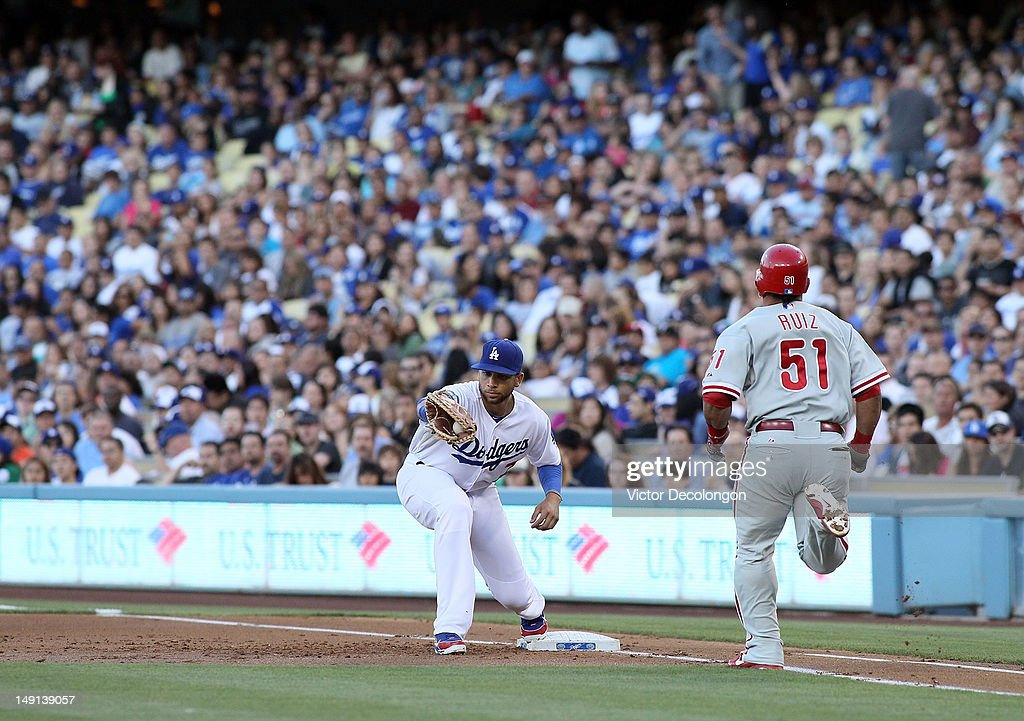 <a gi-track='captionPersonalityLinkClicked' href=/galleries/search?phrase=James+Loney&family=editorial&specificpeople=636293 ng-click='$event.stopPropagation()'>James Loney</a> #7 of the Los Angeles Dodgers makes the catch for the force out at first base on Victor Ruiz #51 of the Philadelphia Phillies during the MLB game at Dodger Stadium on July 17, 2012 in Los Angeles, California. The Phillies defeated the Dodgers 3-2.