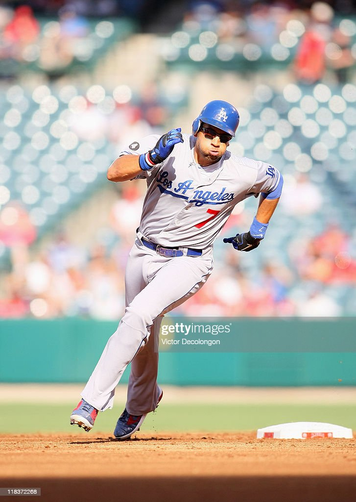 <a gi-track='captionPersonalityLinkClicked' href=/galleries/search?phrase=James+Loney&family=editorial&specificpeople=636293 ng-click='$event.stopPropagation()'>James Loney</a> #7 of the Los Angeles Dodgers runs to third base during their MLB game against the Los Angeles Angels of Anaheim at Angel Stadium of Anaheim on July 3, 2011 in Anaheim, California. The Angels defeated the Dodgers 3-1.