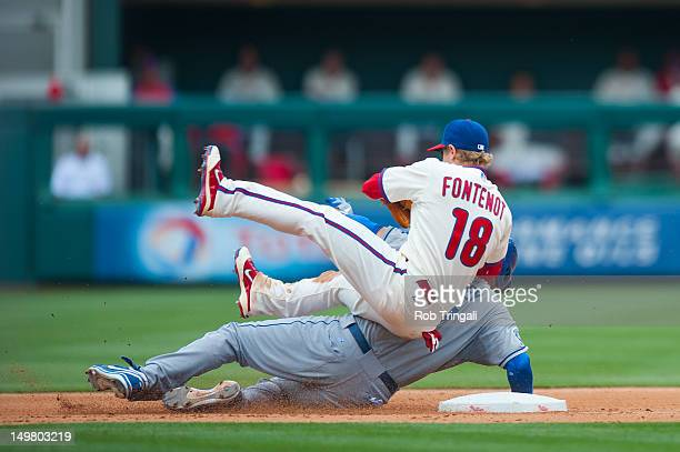 James Loney of the Los Angeles Dodgers slides into second and collides with Mike Fontenot of the Philadelphia Phillies as he defends his position...