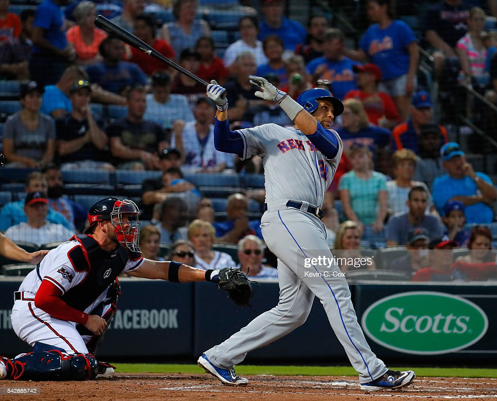 James Loney #28 of the New York Mets hits a three-run homer in the fifth inning against the Atlanta Braves at Turner Field on June 24, 2016 in Atlanta, Georgia.
