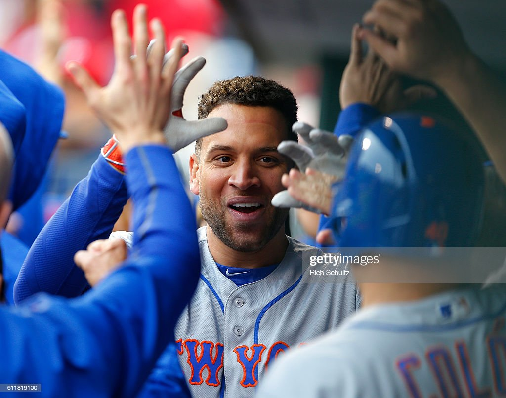 James Loney #28 of the New York Mets is congratulated after hitting a two-run home run against the Philadelphia Phillies during the sixth inning of a game at Citizens Bank Park on October 1, 2016 in Philadelphia, Pennsylvania.