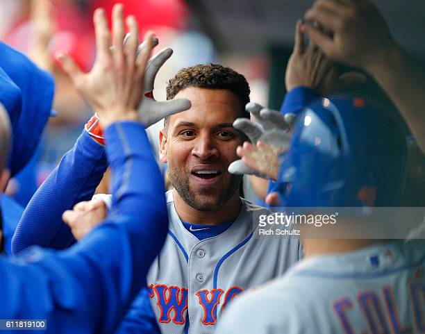James Loney of the New York Mets is congratulated after hitting a tworun home run against the Philadelphia Phillies during the sixth inning of a game...